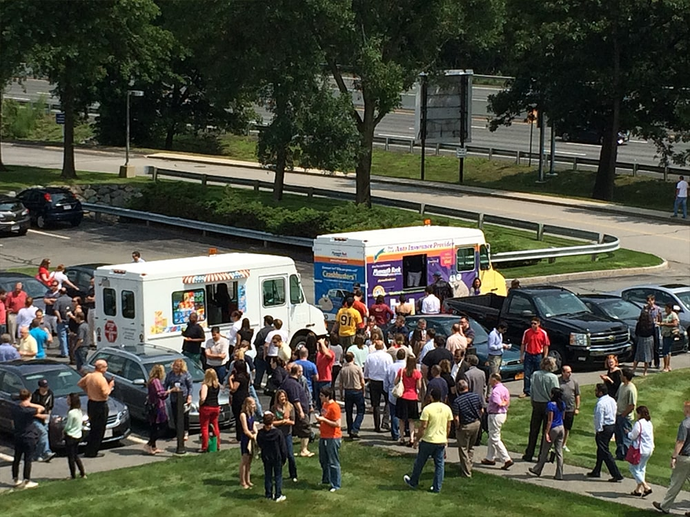 Two Ice Cream Truck Event Crowd Aerial View-min